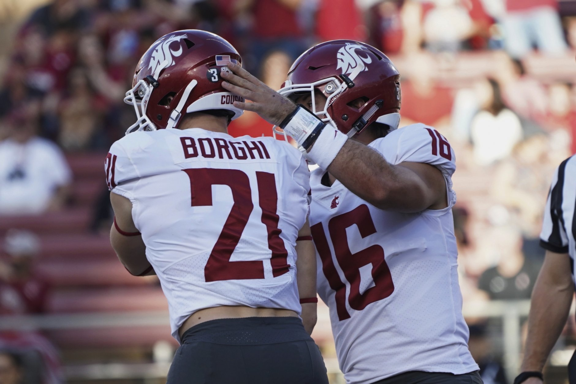 Washington State running back Max Borghi celebrates with quarterback Gardner Minshew II after scoring a touchdown in the first half against Stanford during an NCAA college football game on Saturday, Oct. 27, 2018, in Stanford, Calif. (AP Photo/Don Feria)