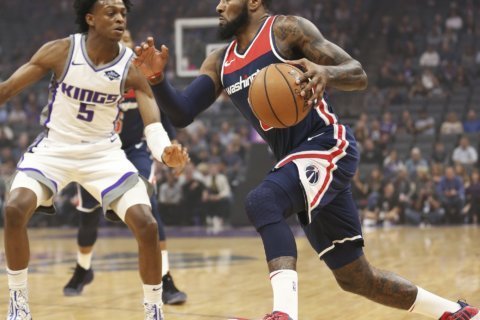 Kings take control in 4th, hold off Wizards 116-112