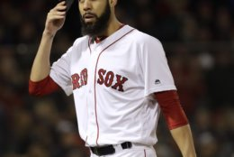 Boston Red Sox's starting pitcher David Price walks off the mound after the first inning of Game 2 of the World Series baseball against the Los Angeles Dodgers game Wednesday, Oct. 24, 2018, in Boston. (AP Photo/David J. Phillip)