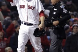 Boston Red Sox pitcher David Price walks off the infield after allowing two runs during the fourth inning of Game 2 of the World Series baseball game against the Los Angeles Dodgers Wednesday, Oct. 24, 2018, in Boston. (AP Photo/David J. Phillip)