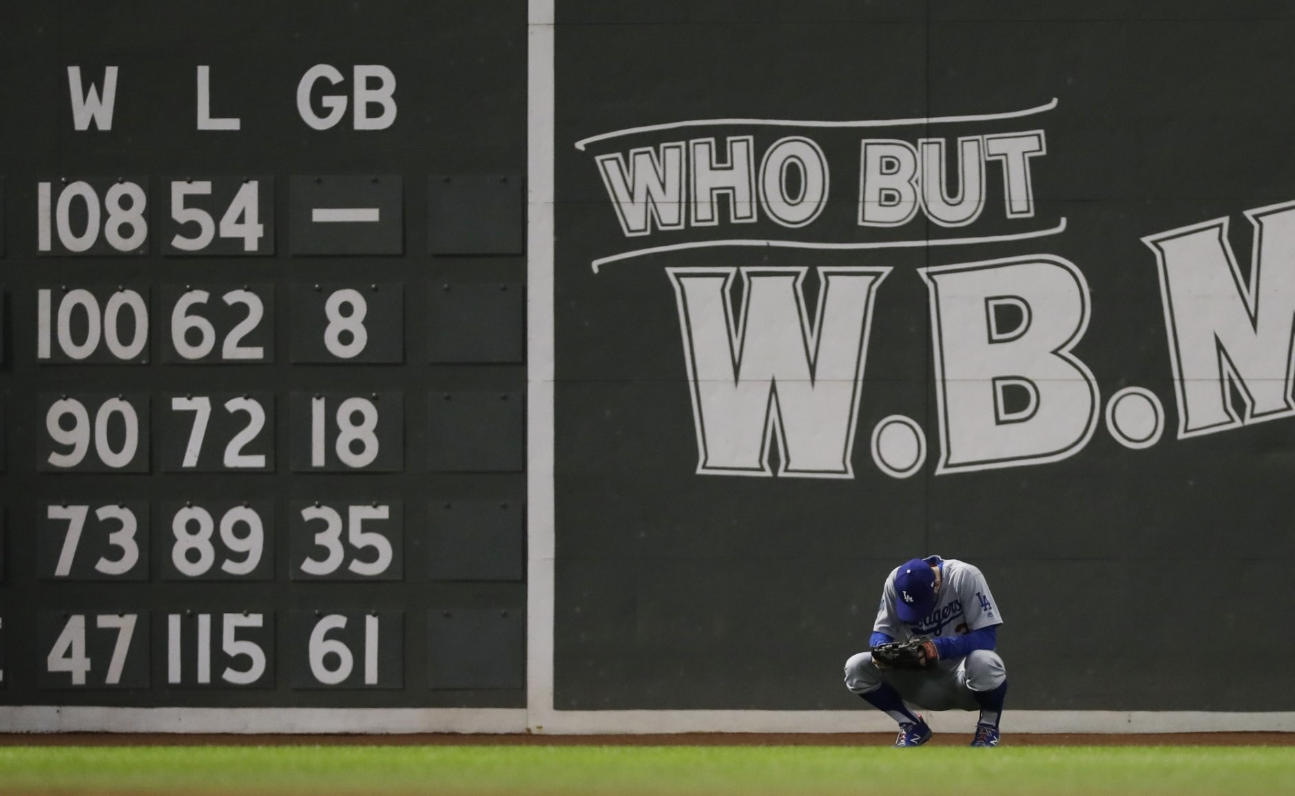 Los Angeles Dodgers outfielder Chris Taylor waits for a pitcher change during the eighth inning of Game 2 of the World Series baseball game against the Boston Red Sox Wednesday, Oct. 24, 2018, in Boston. (AP Photo/David J. Phillip)