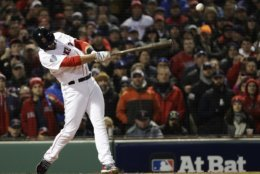 Boston Red Sox's J.D. Martinez hits a two run RBI single during the fifth inning of Game 2 of the World Series baseball game against the Los Angeles Dodgers Wednesday, Oct. 24, 2018, in Boston. (AP Photo/David J. Phillip)
