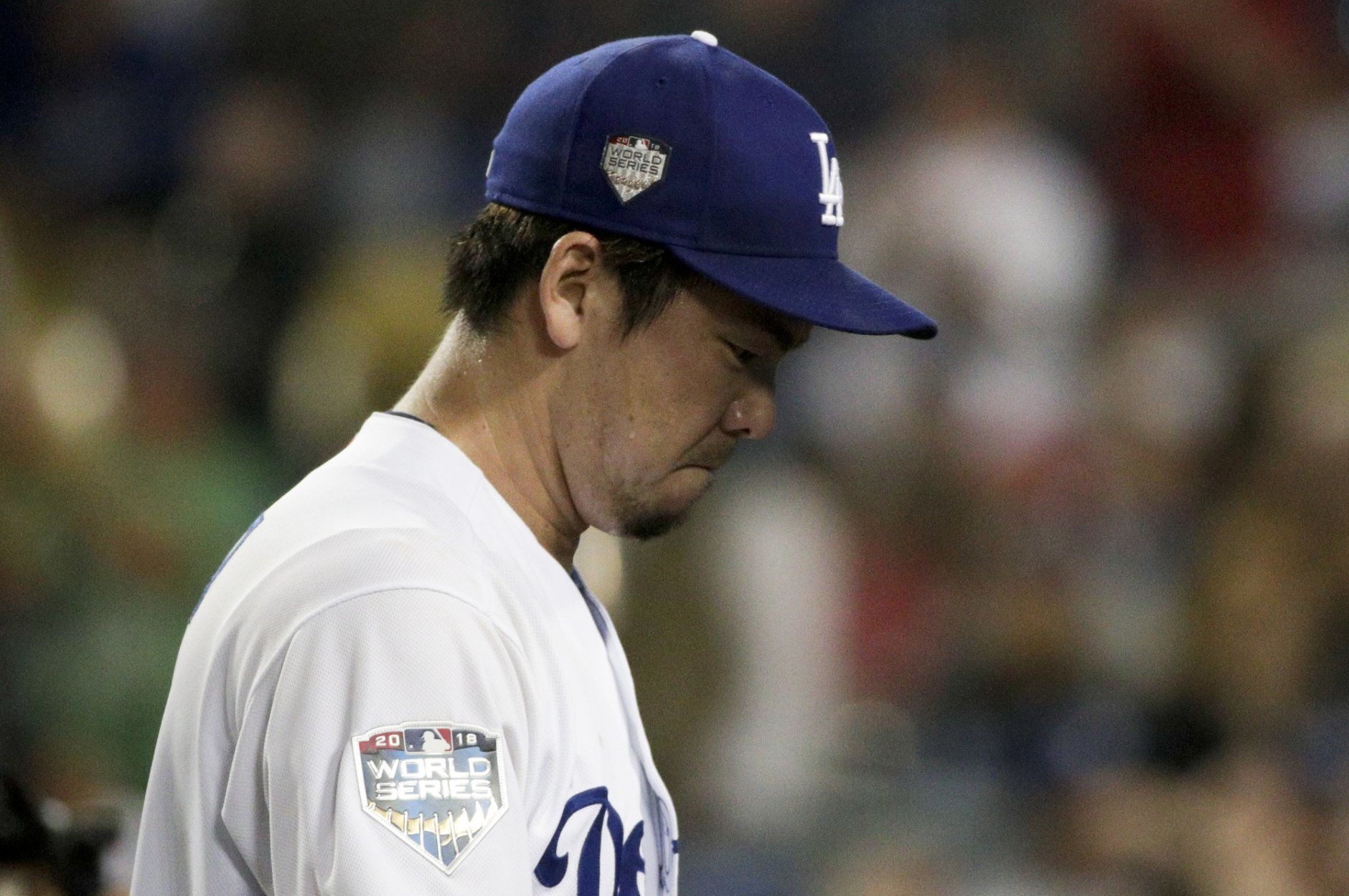 Los Angeles Dodgers pitcher Kenta Maeda leaves the field at the end of the top of the eighth inning against the Boston Red Sox in Game 4 of the World Series baseball game on Saturday, Oct. 27, 2018, in Los Angeles. (AP Photo/Jae C. Hong)