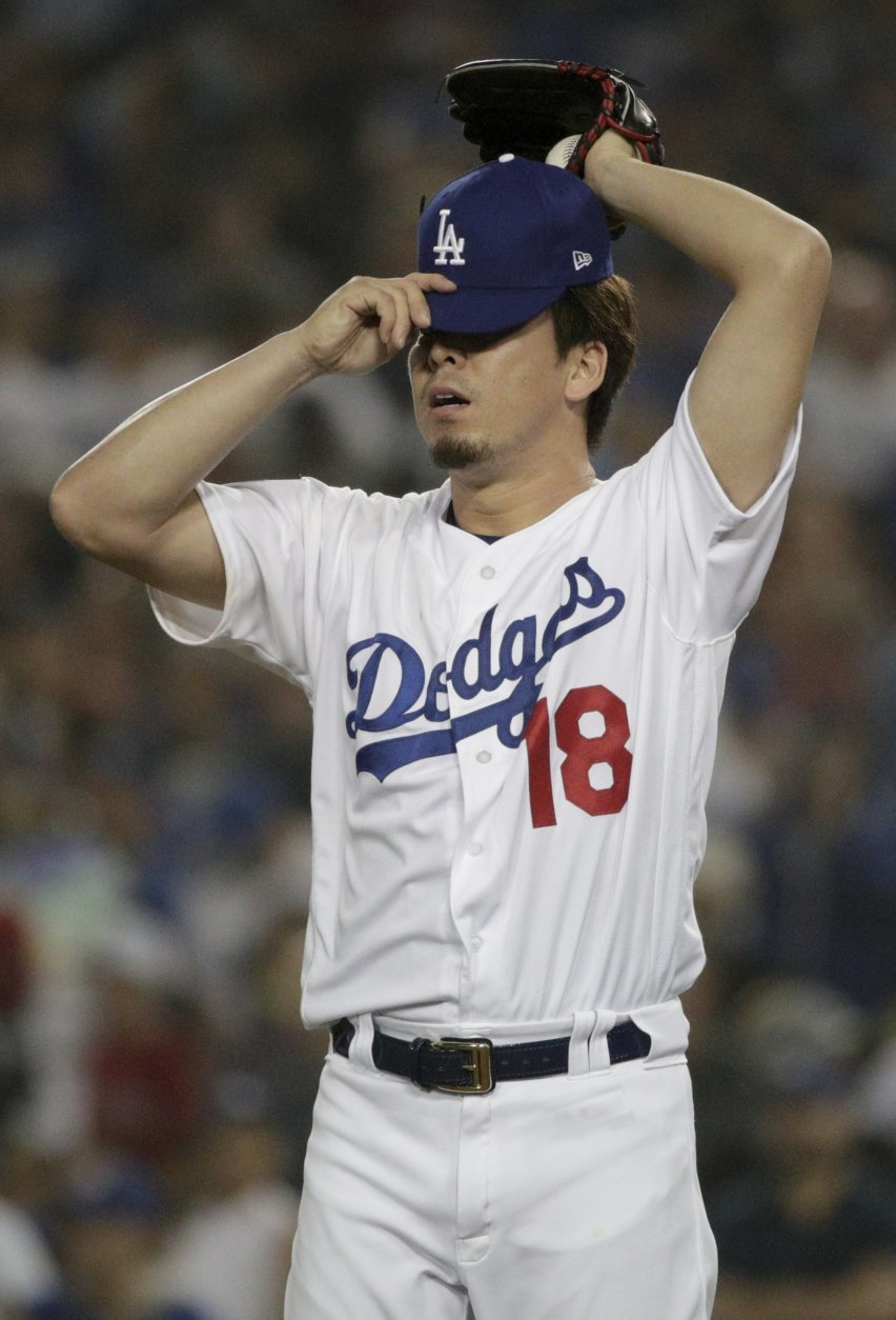 Los Angeles Dodgers pitcher Kenta Maeda reacts after giving up a three RBI-double to Boston Red Sox's Steve Pearce during the ninth inning in Game 4 of the World Series baseball game on Saturday, Oct. 27, 2018, in Los Angeles. (AP Photo/Jae C. Hong)