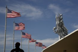 A security guard walks on the upper deck at Dodger Stadium before Game 5 of the World Series baseball game between the Los Angeles Dodgers and the Boston Red Sox on Sunday, Oct. 28, 2018, in Los Angeles. (AP Photo/Jae C. Hong)