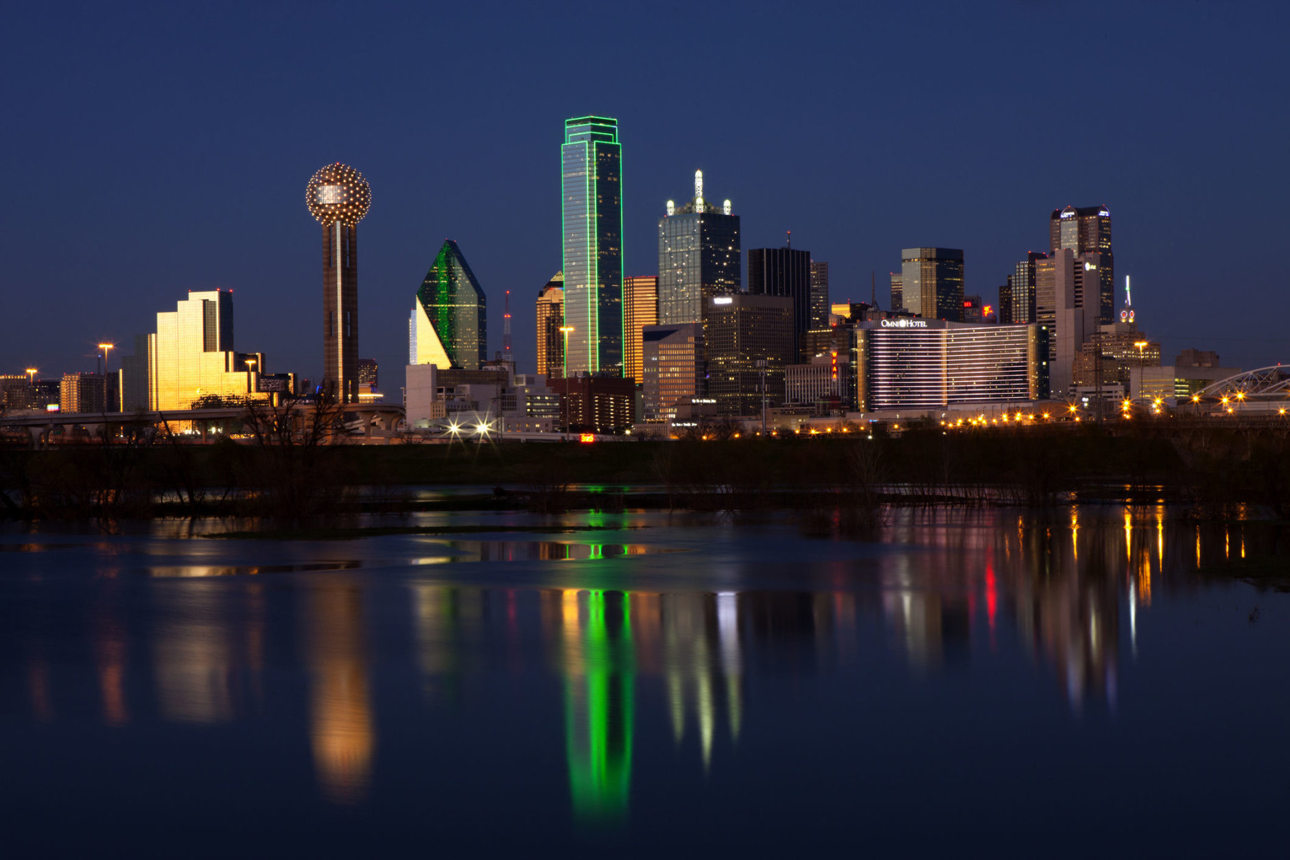 Downtowwn Dallas, Texas at night with the Trinity River in the forground