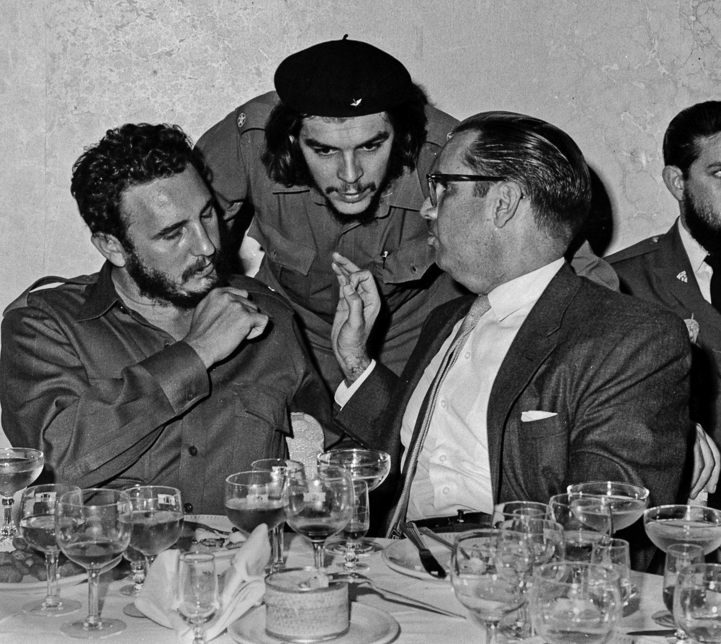 """FILE - In this 1960 file photo, Cuba's revolutionary hero Ernesto """"Che"""" Guevara, center, Cuba's leader Fidel Castro, left, and Cuba's President Osvaldo Dorticos, right, attend a reception in an unknown location in Cuba. Former President Fidel Castro, who led a rebel army to improbable victory in Cuba, embraced Soviet-style communism and defied the power of 10 U.S. presidents during his half century rule, has died at age 90. The bearded revolutionary, who survived a crippling U.S. trade embargo as well as dozens, possibly hundreds, of assassination plots, died eight years after ill health forced him to formally hand power over to his younger brother Raul, who announced his death late Friday, Nov. 25, 2016, on state television. (Prensa Latina via AP Images, File)"""