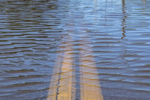 Tidal flooding submerges roads in areas along Potomac River, Chesapeake Bay