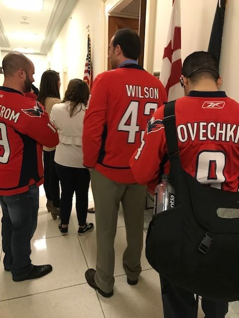 Caps fans wait in line to see the Stanley Cup in the Capitol Hill office of D.C. Del. Eleanor Holmes Norton. (WTOP/Mitch Miller)