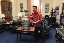 "Alfredo Flores, who saw the Caps lose to the Red Wings in the 1998 Stanley Cup finals, says it's ""thrilling"" to see the cup in D.C. 20 years later. (WTOP/Mitch Miller)"