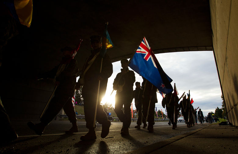 Marines walk with flags near the start of the marathon. (AP Photo/Jose Luis Magana)