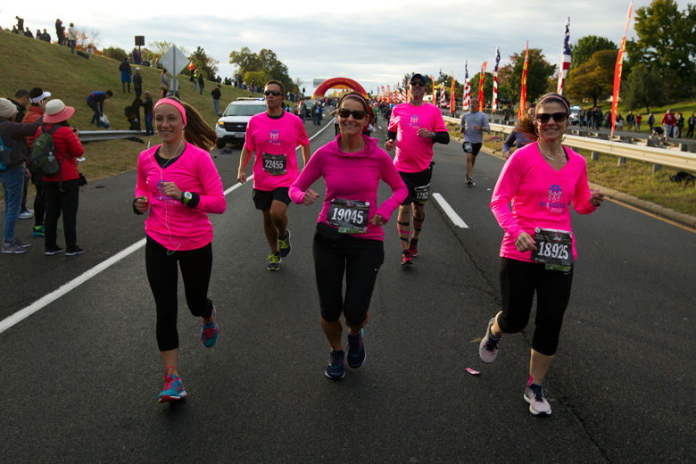 Women wearing pink start the Marine Corps Marathon on Sunday morning. (AP Photo/Jose Luis Magana)