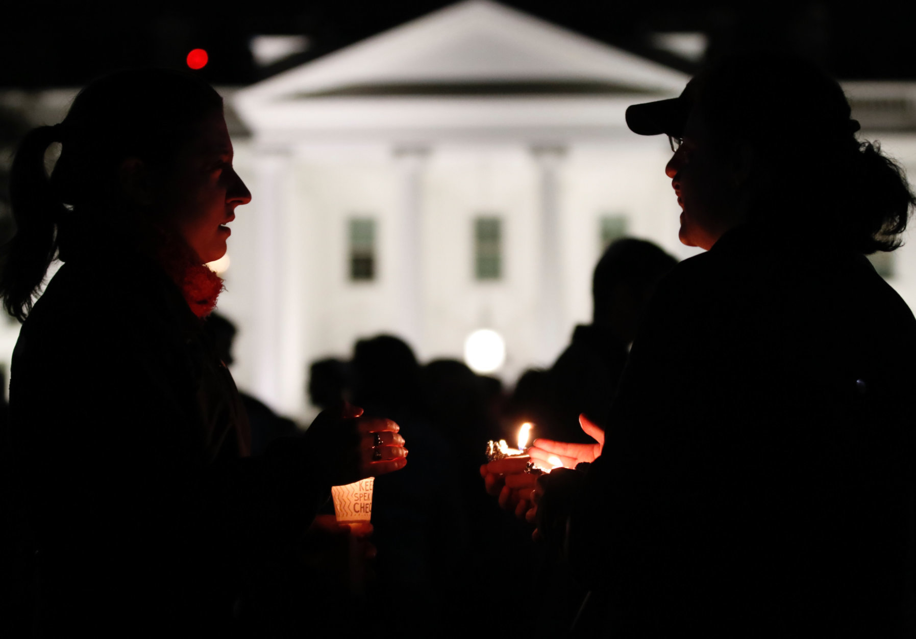 People gather outside the White House for a vigil after a gunman open fired at a Pittsburgh synagogue on Saturday, Oct. 27, 2018. (WTOP/Kate Ryan)