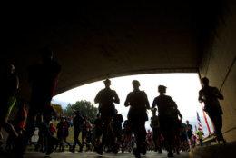 Runners pass under a tunnel near the start of the marathon. (AP Photo/Jose Luis Magana)