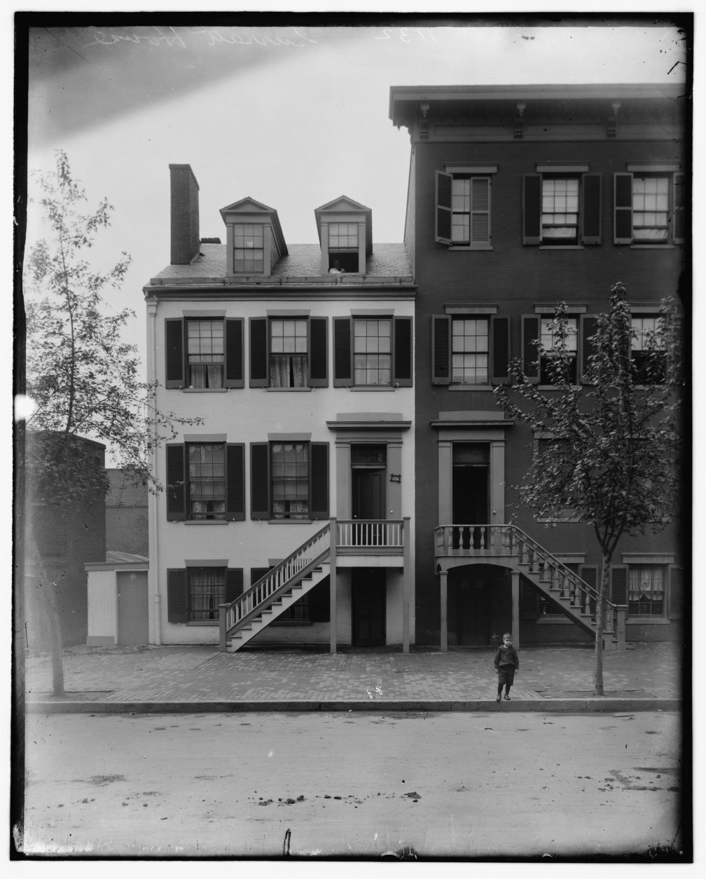 An 1865 photo print of the Surratt House (left) in H St. NW in D.C. (Courtesy Library of Congress)