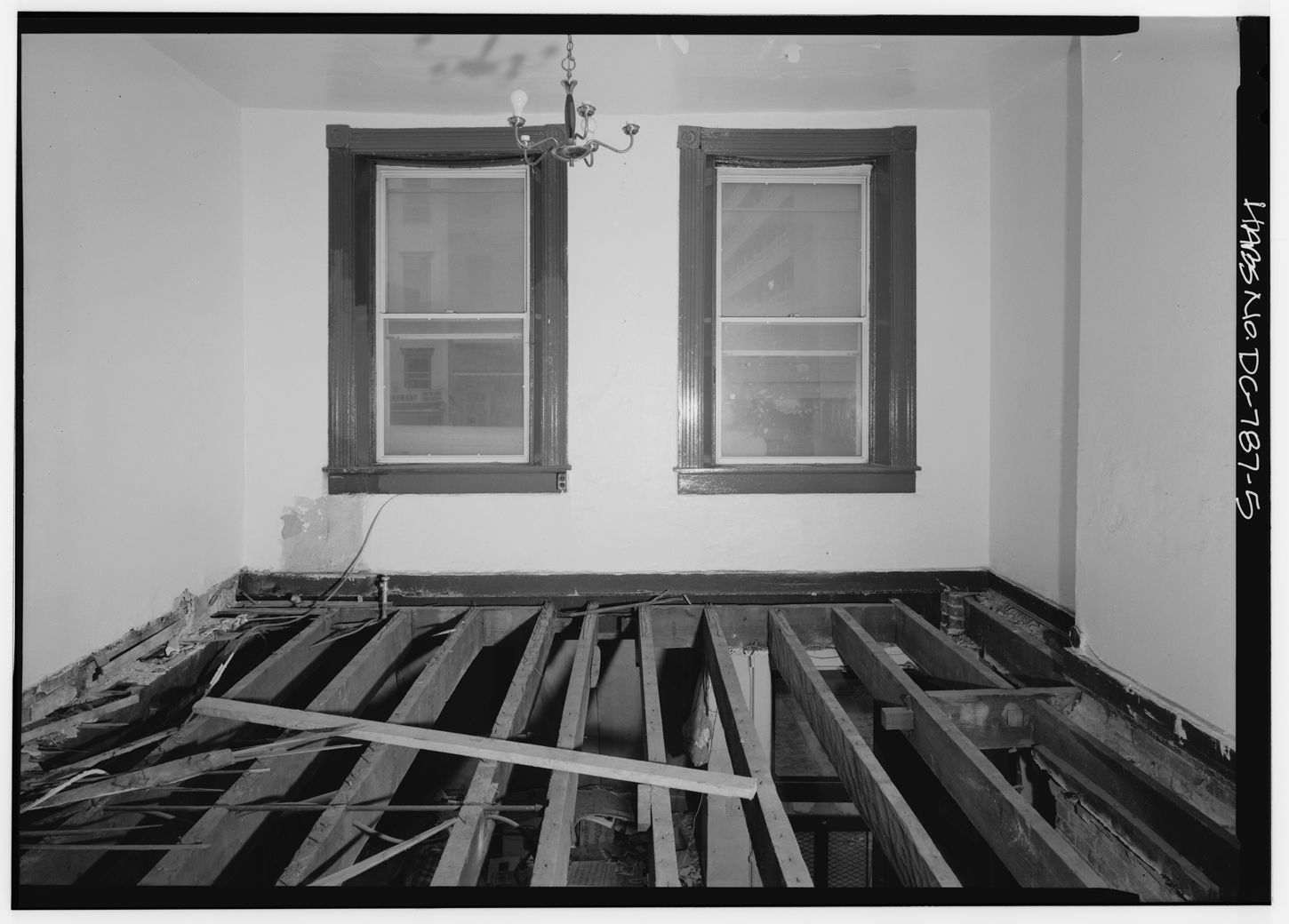 The second-floor front room of the Surratt House during a Historic American Buildings Survey circa 1972. (Courtesy Library of Congress)