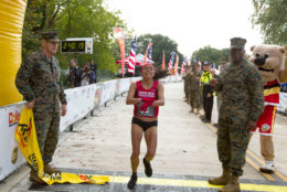 Jenny Mendez of Costa Rica crosses the finish line in first place in the women's division of the 43rd Marine Corps Marathon, Sunday, Oct. 28, 2018, in Arlington, Va. (AP Photo/Jose Luis Magana)