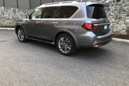 Thankfully, the tall QX80 comes with running boards to help entry and exit but power-folding running boards would be nice. (WTOP/Mike Parris)