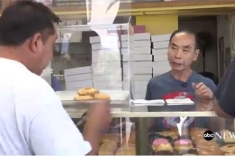 Loyal customers to doughnut shop buy dozens every day to help store owner see his sick wife