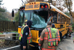 Officials respond to the scene where a bus collided with a trash truck Monday morning in Montgomery County. (Courtesy NBC4/Adam Tuss)