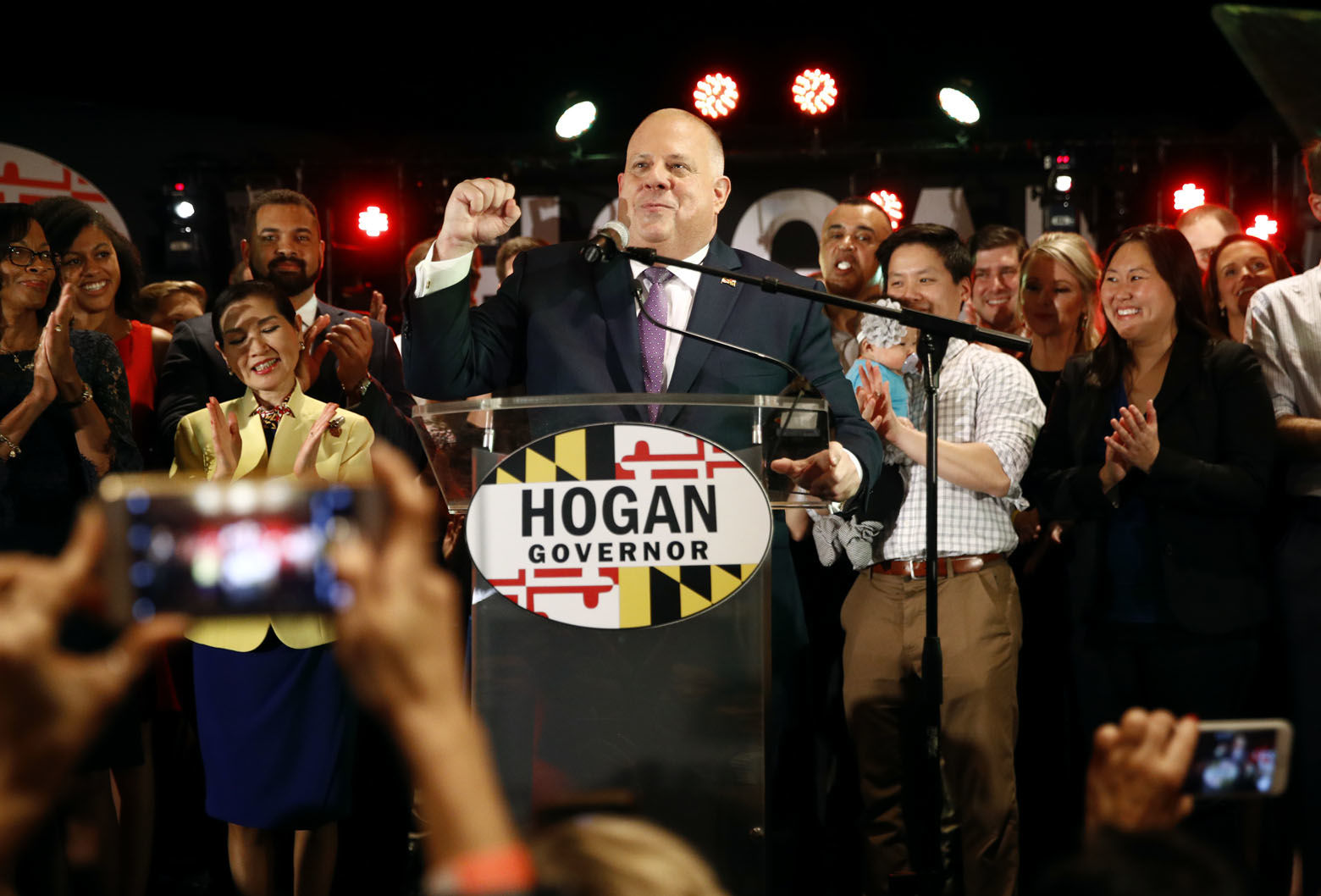 Maryland Gov. Larry Hogan, center, celebrates as he speaks at an election night party, Tuesday, Nov. 6, 2018, in Annapolis, Md. Hogan earned a second term after defeating Democratic opponent Ben Jealous. (AP Photo/Patrick Semansky)