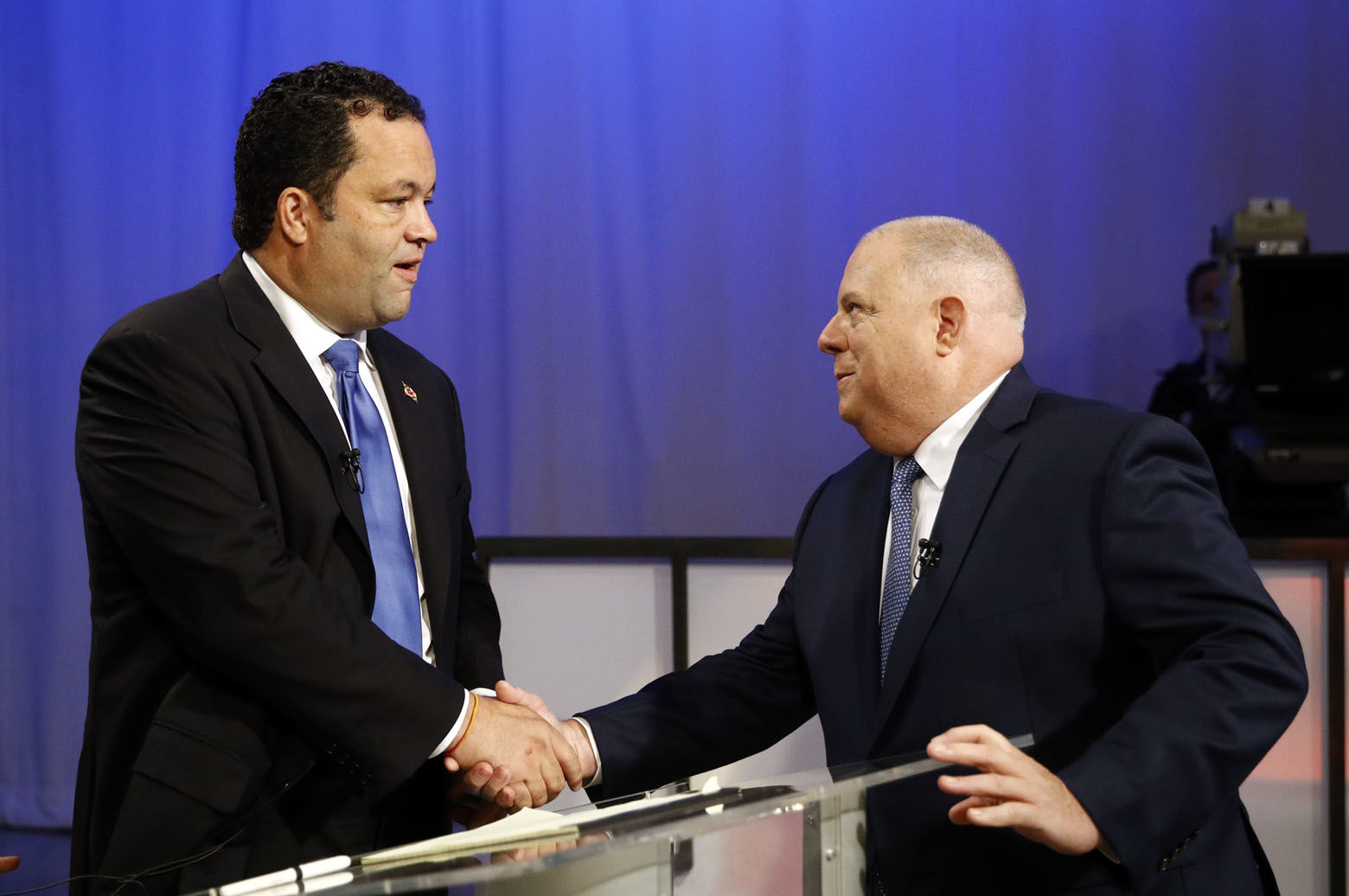 Maryland Democratic gubernatorial candidate Ben Jealous, left, and Republican candidate, Maryland Gov. Larry Hogan, shake hands before participating in a debate Monday, Sept. 24, 2018, at Maryland Public Television's studios in Owings Mills, Md. (AP Photo/Patrick Semansky)