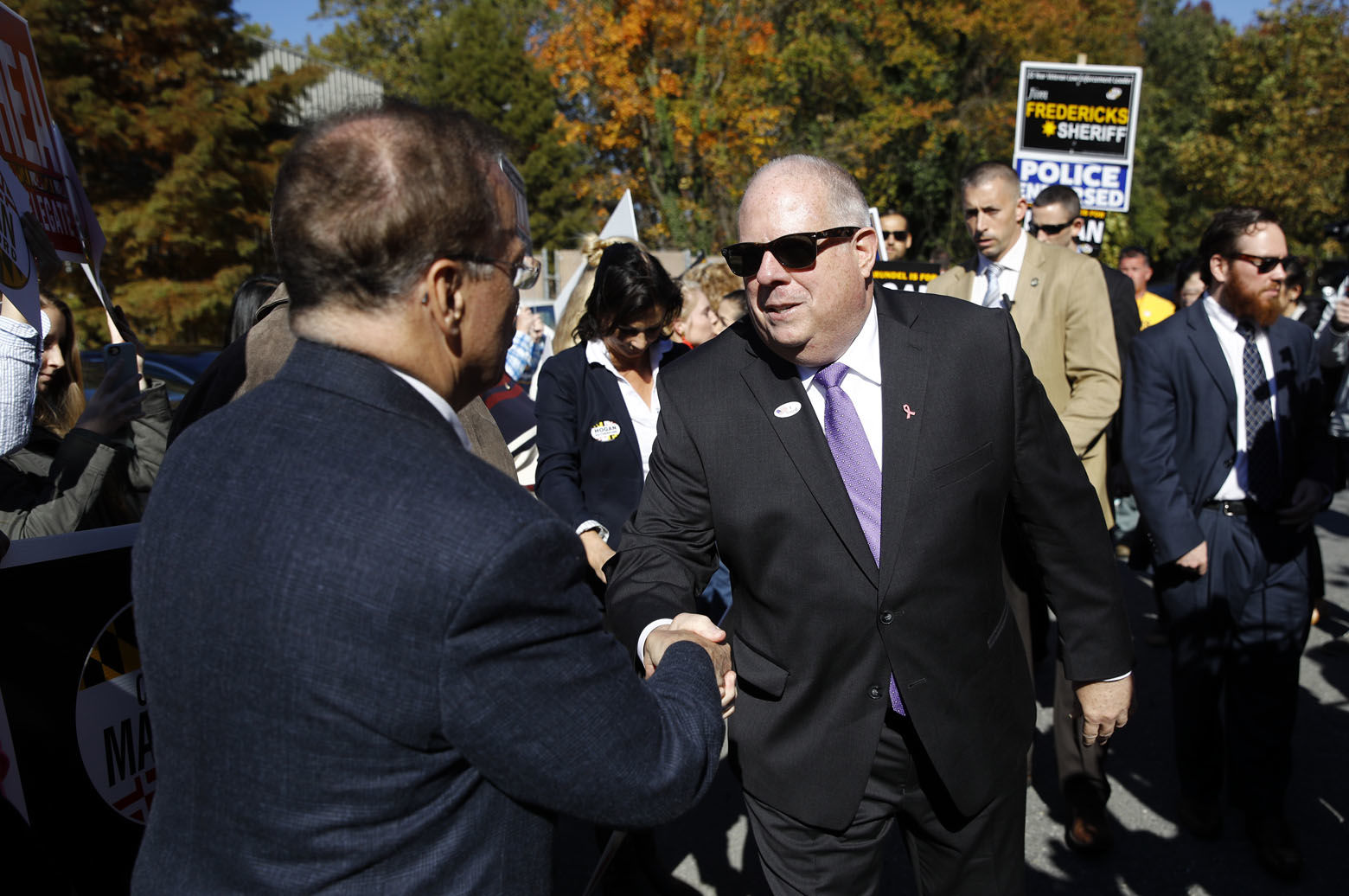 Maryland Gov. Larry Hogan greets supporters outside a polling place after voting early, Tuesday, Oct. 30, 2018, in Annapolis, Md. Hogan is running for re-election against Democratic candidate Ben Jealous. (AP Photo/Patrick Semansky)