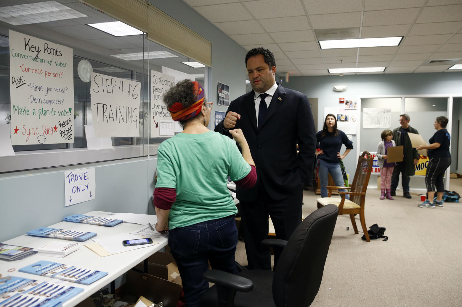 Maryland Democratic gubernatorial candidate Ben Jealous, center right, fist-bumps volunteer Evie Frankl during a visit to a Montgomery County coordinated campaign office, Monday, Nov. 5, 2018, in Silver Spring, Md. Jealous is running against incumbent Gov. Larry Hogan. (AP Photo/Patrick Semansky)