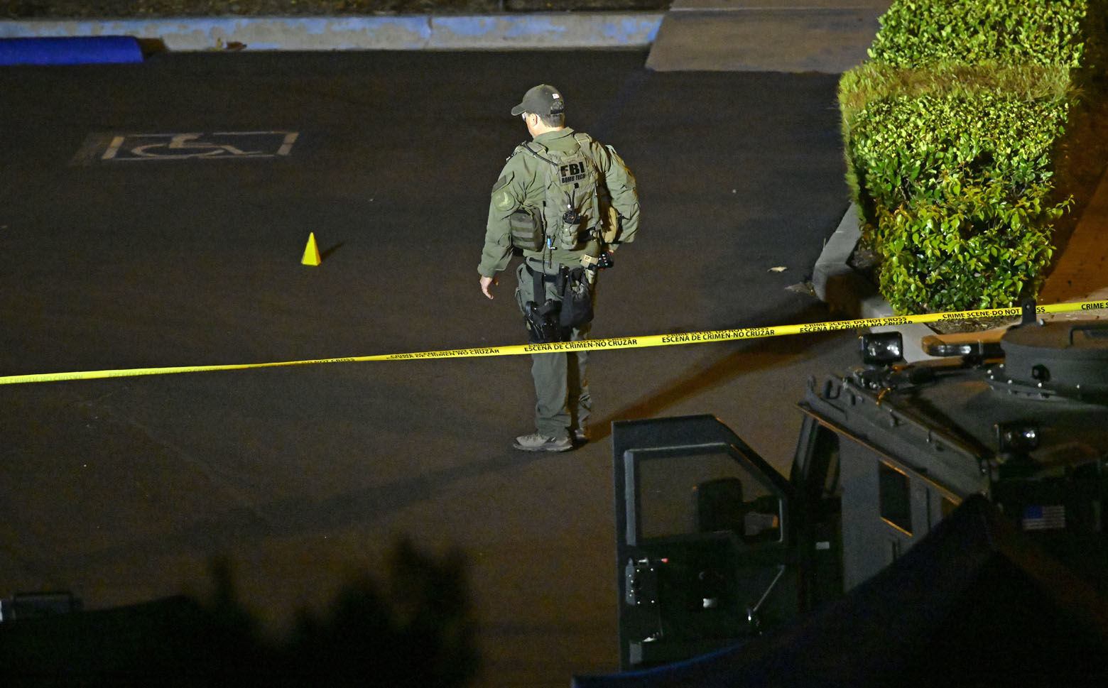 "An FBI agent works the scene Thursday, Nov. 8, 2018, in Thousand Oaks, Calif. where a gunman opened fire Wednesday inside a country dance bar crowded with hundreds of people on ""college night,"" wounding 11 people including a deputy who rushed to the scene. Ventura County sheriff's spokesman says gunman is dead inside the bar. (AP Photo/Mark J. Terrill)"