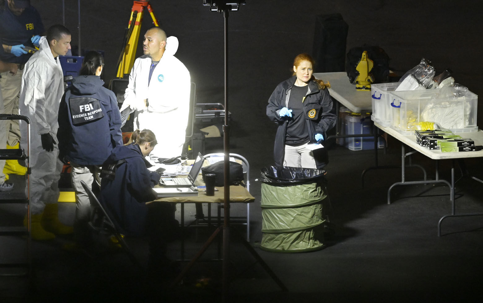"A forensics team gets ready work the scene Thursday, Nov. 8, 2018, in Thousand Oaks, Calif. where a gunman opened fire Wednesday inside a country dance bar crowded with hundreds of people on ""college night,"" wounding 11 people including a deputy who rushed to the scene. Ventura County sheriff's spokesman says gunman is dead inside the bar. (AP Photo/Mark J. Terrill)"