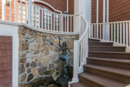 The curved staircase to the home's front entrance. (Courtesy HomeVisit)
