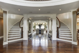 A view of the foyer with butterfly staircase. (Courtesy HomeVisit)