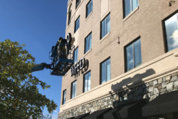 Crews removing WTOP's call letters from its Idaho Avenue location. (WTOP/Ginger Whitaker)