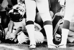 Washington Redskins quarterback Joe Theismann lies on the ground after being injured on the second play of the second quarter during their game with the New York Giants Monday night  Nov 19, 1985 in Washington. Theismann suffered a compound fracture of the lower right leg on the play. (AP Photo/J. Scott Applewhite)