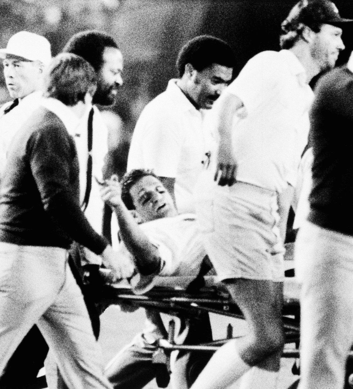 Washington Redskins quarterback Joe Theismann gestures as he is carried off the field at R.F.K. Stadium Monday night  Nov. 18, 1985 in Washington. Theismann injured his right leg during second quarter action. (AP Photo/J. Scott Applewhite)