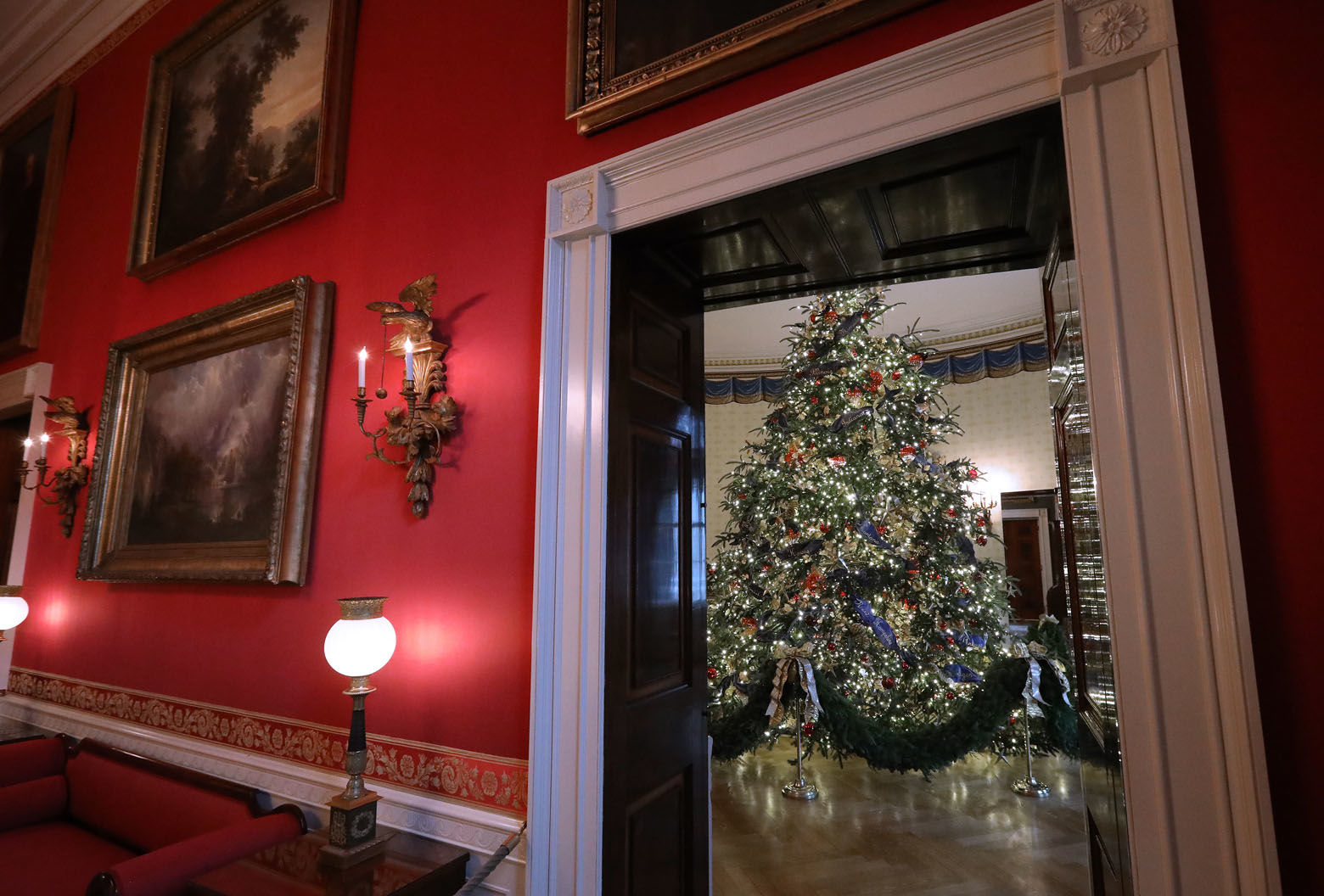 WASHINGTON, DC - NOVEMBER 26: At 18 feet tall, the official White House Christmas is dressed in over 500 feet of blue velvet ribbon embroidered in gold with each state and territory, on display inside the Blue Room at the White House November 26, 2018 in Washington, DC. The 2018 theme of the White House holiday decorations is 'American Treasures,' and features patriotic displays highlighting the country's 'unique heritage.' The White House expects to host 100 open houses and more than 30,000 guests who will tour the topiary trees, architectural models of major U.S. cities, the Gold Star family tree and national monuments in gingerbread. (Photo by Chip Somodevilla/Getty Images)