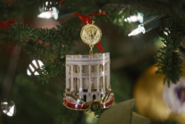 "The Official 2018 White House Christmas Ornament is seen during the 2018 Christmas Press Preview at the White House in Washington, Monday, Nov. 26, 2018. Christmas has arrived at the White House. First lady Melania Trump unveiled the 2018 White House holiday decor on Monday. She designed the decor, which features a theme of ""American Treasures."" (AP Photo/Carolyn Kaster)"