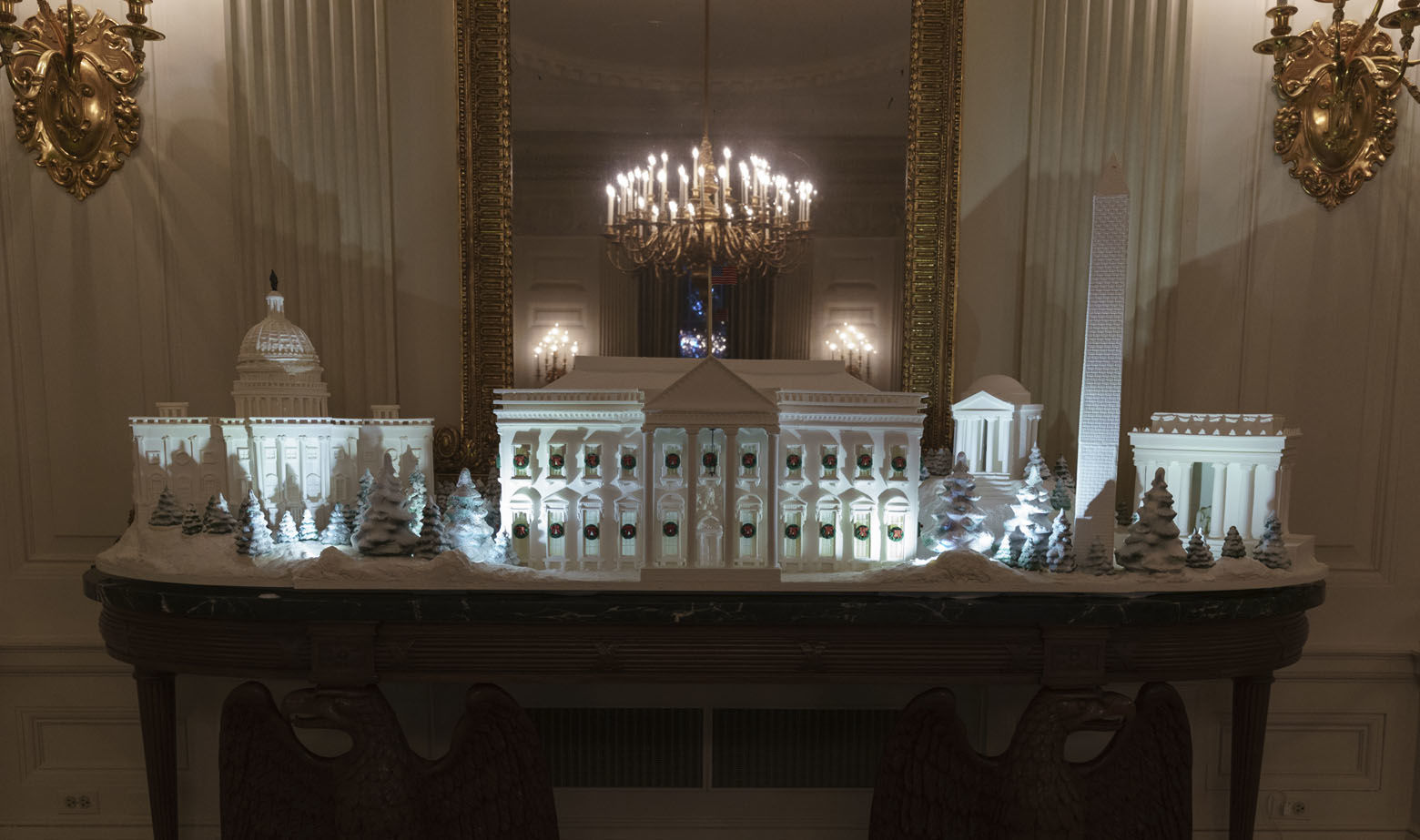 "The gingerbread house, showcasing the full expanse of the National Mall: the Capitol, the Lincoln Memorial, the Jefferson Memorial, the Washington Monument, and, the White House is seen in the State Dining Room during the 2018 Christmas Press Preview at the White House in Washington, Monday, Nov. 26, 2018. Christmas has arrived at the White House. First lady Melania Trump unveiled the 2018 White House holiday decor on Monday. She designed the decor, which features a theme of ""American Treasures."" (AP Photo/Carolyn Kaster)"