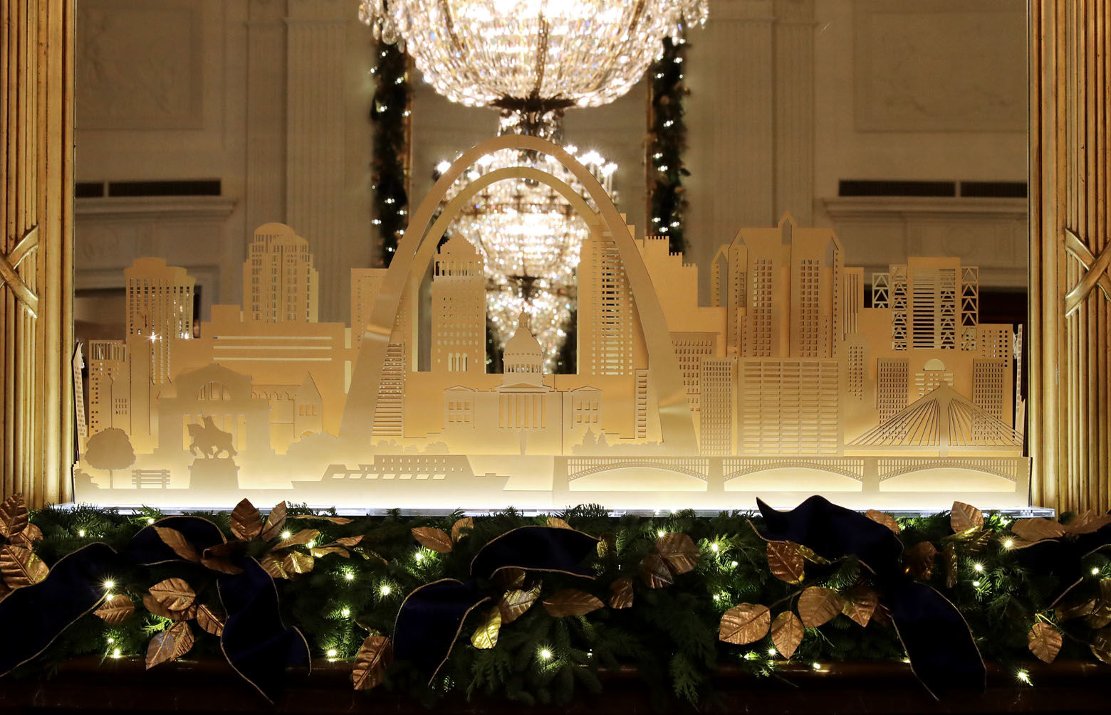 WASHINGTON, DC - NOVEMBER 26: Holiday decorations in the East Room celebrate American architecture and design with a custom mantelpiece of the St. Louis skyline at the White House November 26, 2018 in Washington, DC. The 2018 theme of the White House holiday decorations is 'American Treasures,' and features patriotic displays highlighting the country's 'unique heritage.' The White House expects to host 100 open houses and more than 30,000 guests who will tour the topiary trees, architectural models of major U.S. cities, the Gold Star family tree and national monuments in gingerbread. (Photo by Chip Somodevilla/Getty Images)