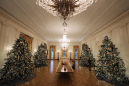 WASHINGTON, DC - NOVEMBER 26: Four 14-foot-tall Nobel fir trees with 72 handmade paper ornaments representing six regions across America stand in the East Room of the White House November 26, 2018 in Washington, DC. The 2018 theme of the White House holiday decorations is 'American Treasures,' and features patriotic displays highlighting the country's 'unique heritage.' The White House expects to host 100 open houses and more than 30,000 guests who will tour the topiary trees, architectural models of major U.S. cities, the Gold Star family tree and national monuments in gingerbread. (Photo by Chip Somodevilla/Getty Images)