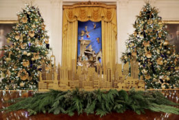 WASHINGTON, DC - NOVEMBER 26: Four 14-foot-tall Nobel fir trees with 72 handmade paper ornaments representing six regions across America stand next to the White House Crèche in the East Room of the White House November 26, 2018 in Washington, DC. The 2018 theme of the White House holiday decorations is 'American Treasures,' and features patriotic displays highlighting the country's 'unique heritage.' The White House expects to host 100 open houses and more than 30,000 guests who will tour the topiary trees, architectural models of major U.S. cities, the Gold Star family tree and national monuments in gingerbread. (Photo by Chip Somodevilla/Getty Images)