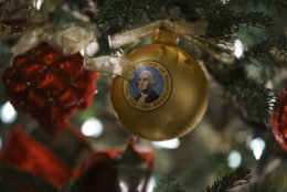"An ornament with an image of President George Washington is seen during the 2018 Christmas preview at the White House in Washington, Monday, Nov. 26, 2018. Christmas has arrived at the White House for 2018 as first lady Melania Trump unveiled the holiday decor. She designed the decor, which features a theme of ""American Treasures."" (AP Photo/Carolyn Kaster)"