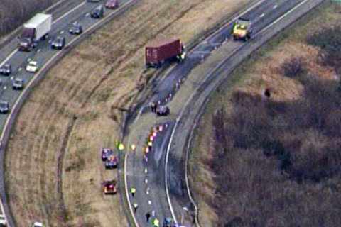 Inmate dead after tractor-trailer strikes him on I-70; 3 others on work crew hurt
