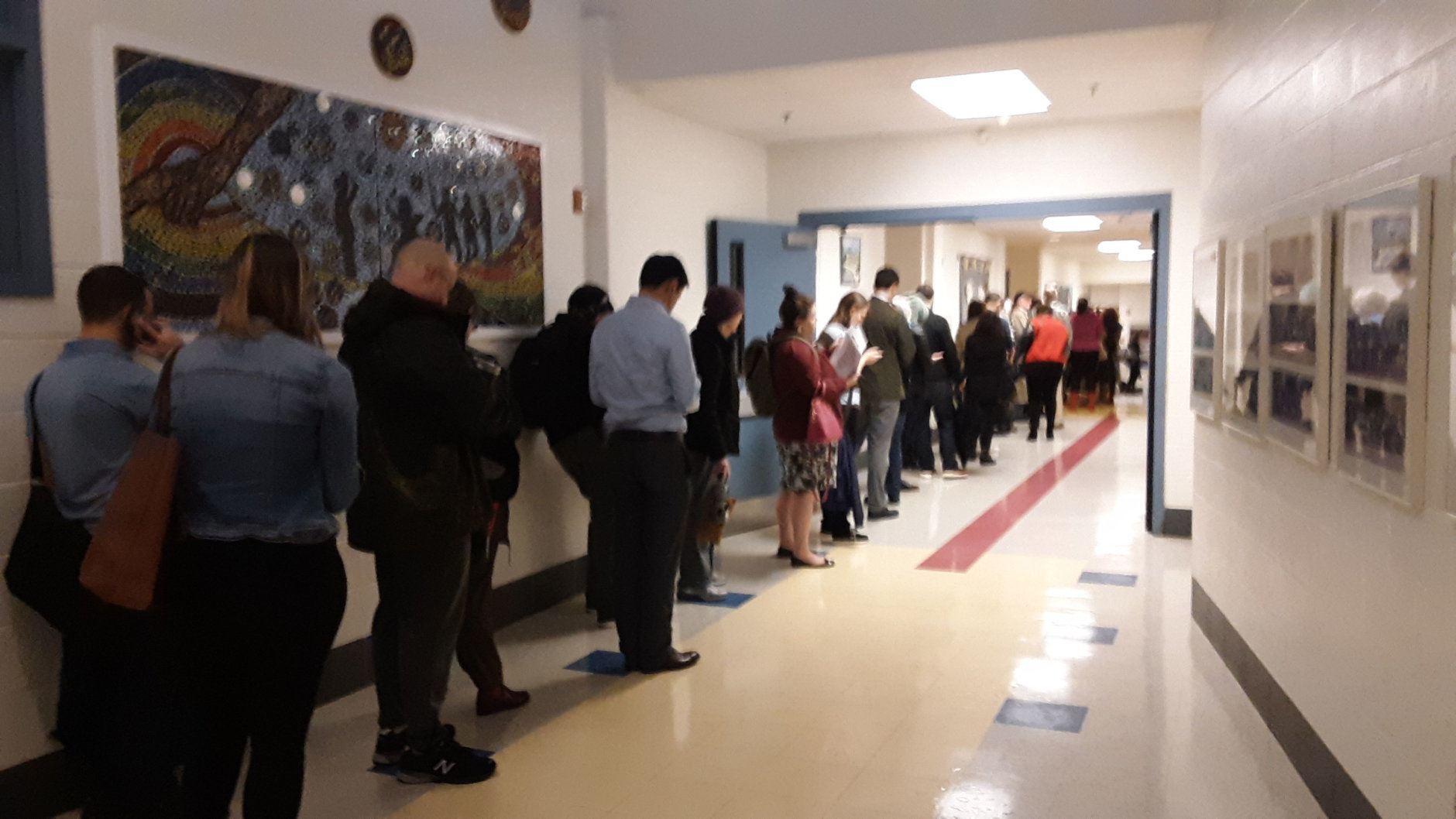 A line of voters wait in line at the poll at Bethesda Elementary in Montgomery County, Maryland. (WTOP/Lisa Weiner)
