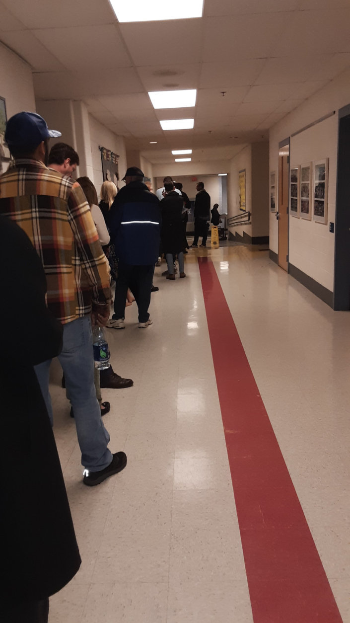 A line of voters wait to cast their votes at the poll at Bethesda Elementary in Montgomery County, Maryland. (WTOP/Lisa Weiner)