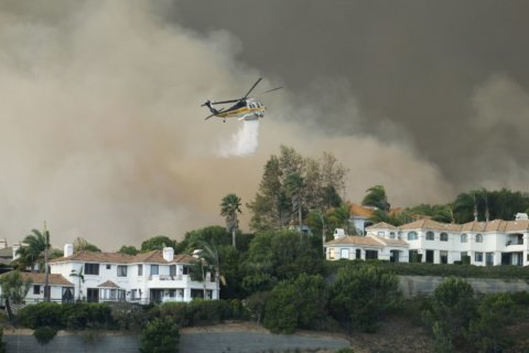 2 dead, homes destroyed in Southern California wildfires