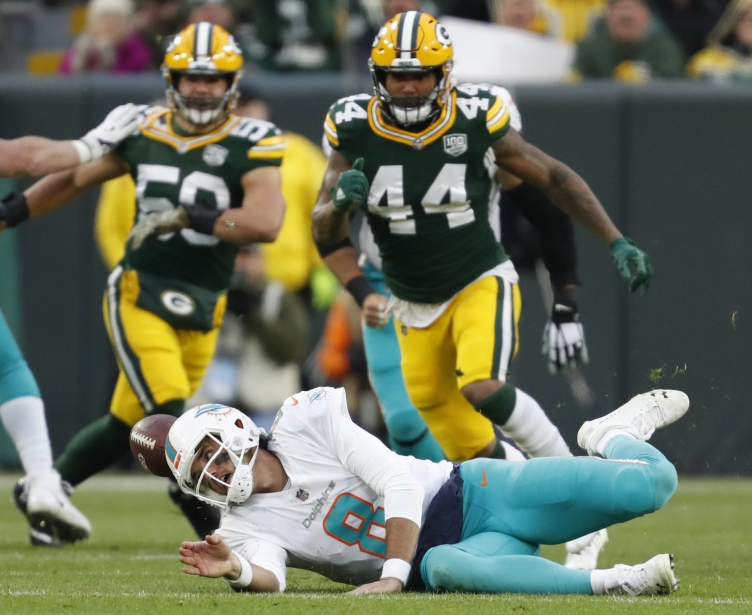 Miami Dolphins quarterback Brock Osweiler fumbles the ball during the first half of an NFL football game against the Green Bay Packers Sunday, Nov. 11, 2018, in Green Bay, Wis. (AP Photo/Matt Ludtke)