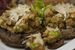 This photo taken Nov. 4, 2009 shows that by nestling stuffing in portobello mushroom caps and baking you have a new take on classic Thanksgiving leftovers. Top with Parmesan once out of the oven. (AP Photo/Larry Crowe)