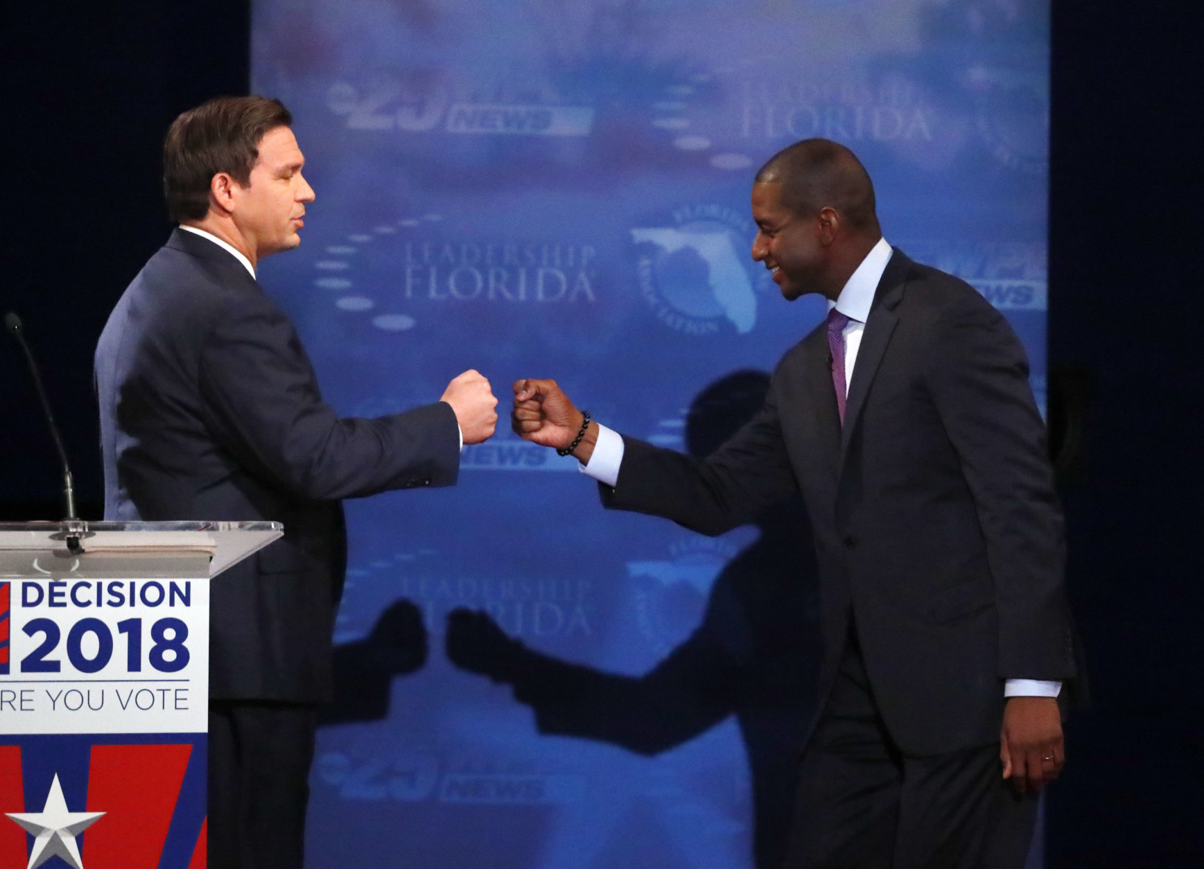 IN this Oct. 24, 2018, photo, Florida gubernatorial candidates, Republican Ron DeSantis, left, and Democrat Andrew Gillum fist bump after a debate at Broward College in Davie, Fla. The final stretch of the midterm campaign is increasingly dominated by debate over one of the most sensitive issues in American political culture: Race. In Florida, accusations of racism are playing a central role in the hotly-contested campaign for governor. DeSantis chafed at questions about his ties to supporters who have made inflammatory comments. (AP Photo/Wilfredo Lee, Pool)