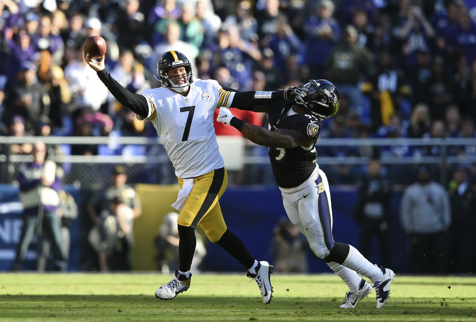 Pittsburgh Steelers quarterback Ben Roethlisberger (7) throws a pass as he tries to avoid Baltimore Ravens outside linebacker Matt Judon in the first half of an NFL football game, Sunday, Nov. 4, 2018, in Baltimore. (AP Photo/Gail Burton)a